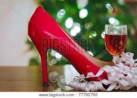 red Christmas shoe and wine