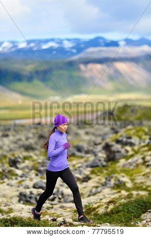 Runner. Sport running woman in cross country trail run. Female athlete exercising and training outdoors in beautiful mountain nature landscape.