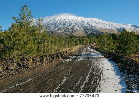 dirt trail to the volcano Etna snow covered, Sicily