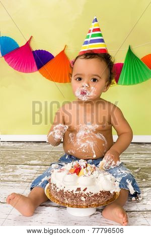 Adorable african baby during a cake smash on his first birthday