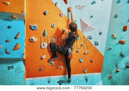 Woman Climbing Up On Practice Wall