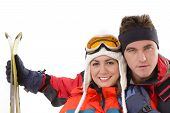 picture of ski boots  - Happy couple in ski suit relaxing isolated on white - JPG