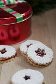 picture of linzer  - Raspberry Linzer cookies on a wooden work bench - JPG