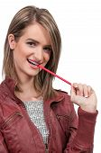 stock photo of midterm  - Beautiful woman college student chewing on a pencil - JPG