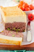 foto of meatloaf  - Beef Meatloaf with Green Peas Topped with Cheesy Mashed Potato copy space for your text - JPG