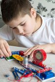 stock photo of pre-teen boy  - a Teen boy at home with electronic project - JPG