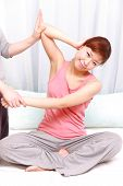 stock photo of thai massage  - Woman Getting Thai Massage at the health spa - JPG