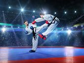 foto of arena  - Two professional female karate fighters are fighting on the grand arena - JPG