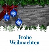 picture of weihnachten  - Christmas greeting in german against christmas baubles hanging over wood - JPG