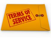 pic of restriction  - Terms of Service words on stamp on yellow envelope to illustrate a contract - JPG