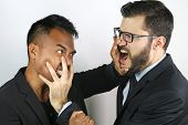 stock photo of strangle  - two young businessmen fighting on a studio background - JPG