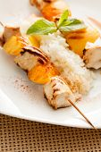 stock photo of souvlaki  - chicken kebab with rice - JPG