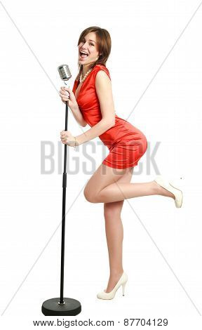 Attractive Young Girl In A Red Dress Singing, Studio, Isolated On White