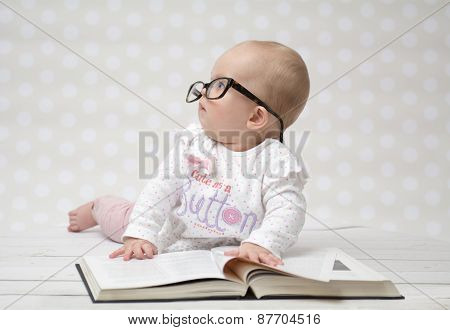 Funny Baby Girl Reading A Book