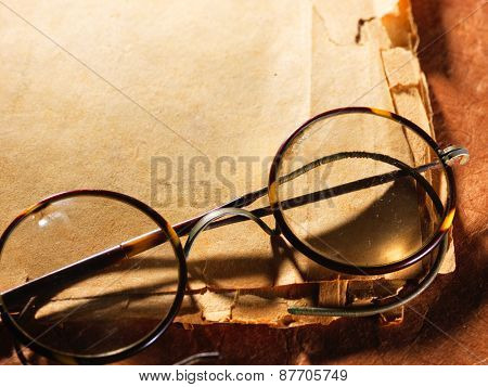 Vintage glasses on the very old paper