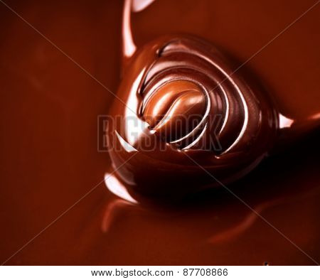 Chocolate praline. Chocolates background. Chocolate. Liquid chocolate. dark and milk chocolate. Sweets
