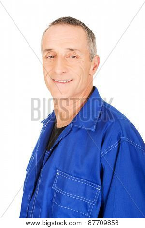 Smiling mature confident repairman in uniform.