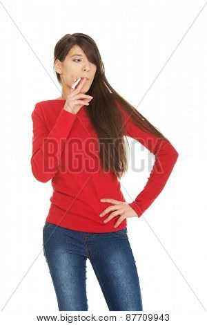 Young student woman smoking cigarette.