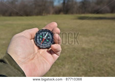 Compass In The Hand On A Walk.