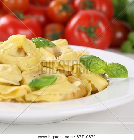 Italian Cuisine Pasta Tortellini Noodles Meal With Tomatoes On Plate
