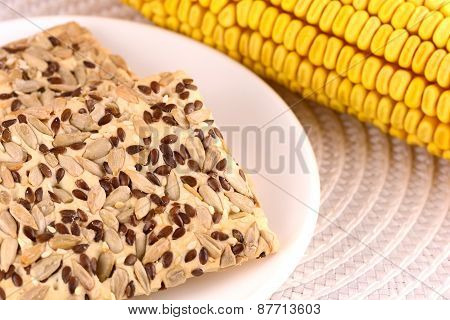 Sweet Cake On White Plate And Corn