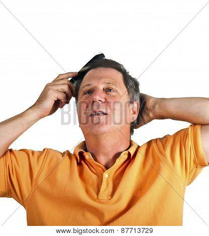Attractive Man Combing His Hair