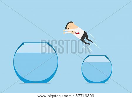Businessman jumping out from one fish bowl to other