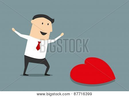 Happy businessman finding a love heart