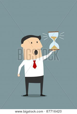 Businessman with sandglass worrying about deadline