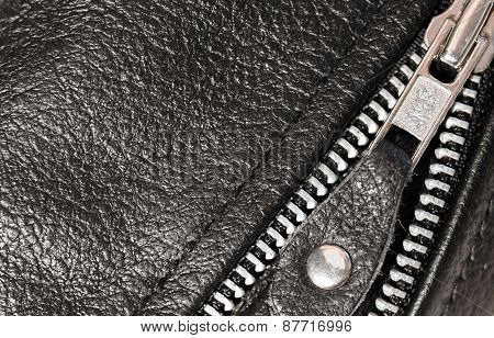 Part Black Leather Clothing With A Zipper. Macro
