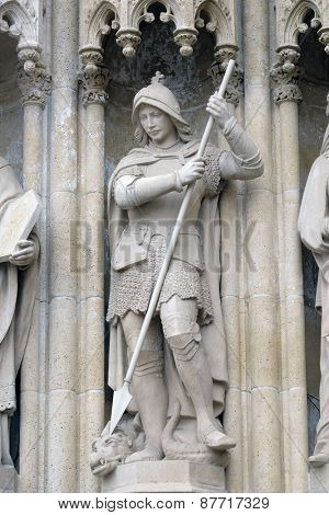 ZAGREB, CROATIA - APRIL 04: Statue of Saint George on the portal of the cathedral dedicated to the Assumption of Mary and to kings Saint Stephen and Saint Ladislaus in Zagreb on April 04, 2015