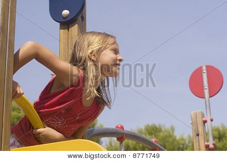 child on playground looking at distance