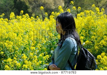 Asian Woman in a field of Yellow Flowers