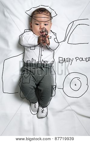 Cute baby boy decorated as a police officer