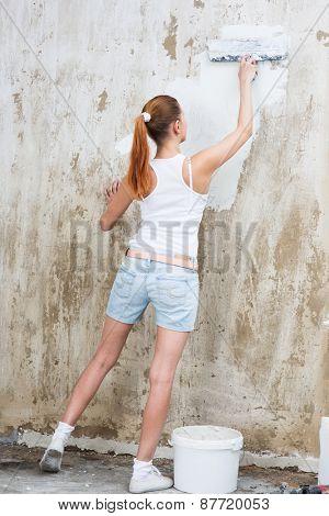 Young Woman repair her apartment