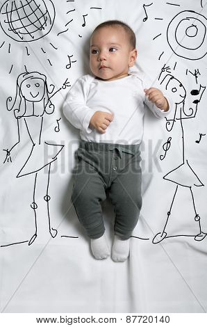 Cute baby boy decorated as a dancer