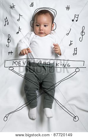 Cute baby boy decorated as a pianist