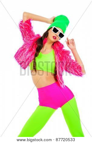 Trendy girl posing in vivid colourful clothes and sunglasses. Party style. Bright fashion. Optics, eyewear. Studio shot.