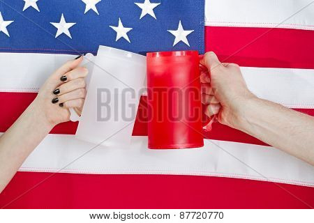 Hands Holding Drinking Mugs With Usa Flag In Background