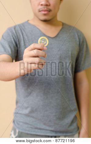Hand Holding Condom