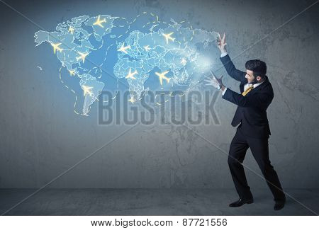 Business person showing digital blue map with planes around the world concept