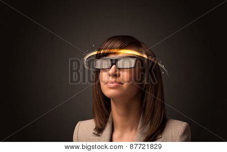 Pretty woman looking with futuristic high tech glasses concept