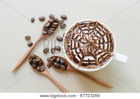 A Cup Of Coffee With Latte Art On Brown Paper Background