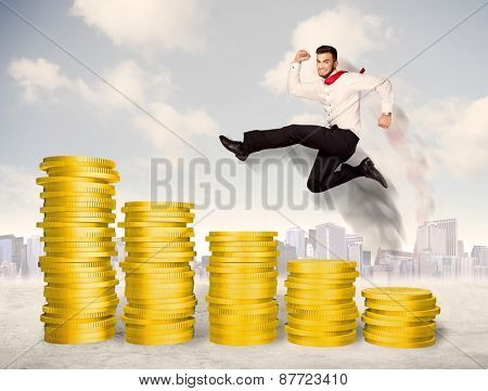 Successful business man jumping up on gold coin money concept
