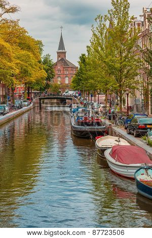 Amsterdam canal, church and typical houses, Holland, Netherlands.
