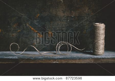 Jute twine on wooden shelf