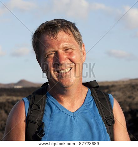 Man On Walking Trail Thru Volcanic Area In Lanzarote