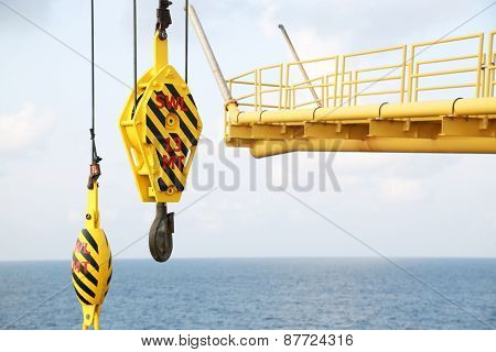 Crane hooks on work site, Crane on Oil and gas platform for transfer cargo and Controlled by Crane