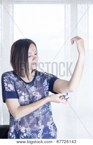 Woman Applying The Sensor.