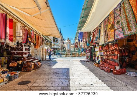 JERUSALEM, ISRAEL - JULY 10, 2014: Bazaar in Old City of Jerusalem offers middle east traditional products and souvenirs. It is very popular with locals, tourists and pilgrims visiting Israel.